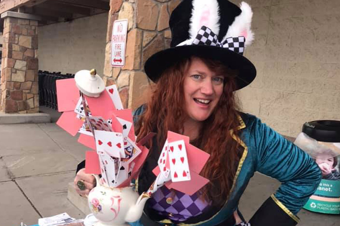 A woman dressed as the Mad Hatter promoting a murder mystery fundraiser for Pagosa Play Place